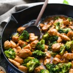 Close up side shot of Chinese Chicken Broccoli Stir Fry in a cast iron skillet