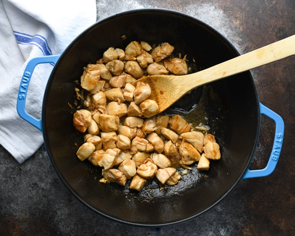 Process shot showing how to make easy chicken and broccoli stir fry recipe in a wok