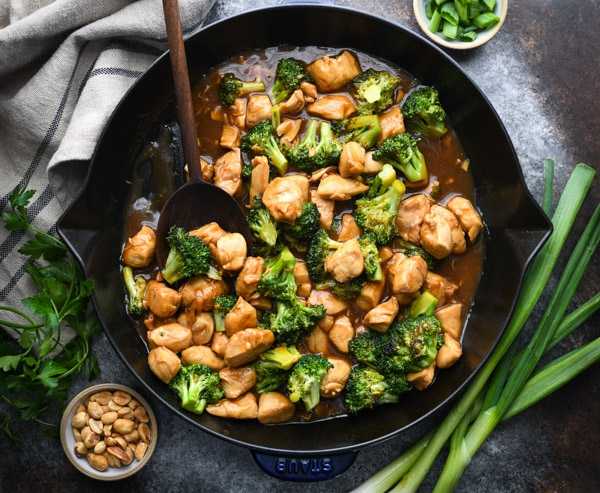 Horizontal overhead shot of Chinese chicken broccoli stir fry in a skillet