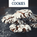 Side shot of the best fudgy chocolate crinkle cookies on a cooling rack with text title overlay