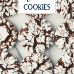 Overhead shot of chocolate crinkle cookies on a white surface with text title overlay