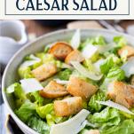 Close up bowl of caesar salad with text title box at top