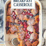 Overhead image of a pan of sweet croissant breakfast casserole with text title overlay