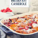 Side shot of a croissant breakfast casserole in a blue dish with text title overlay