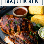 Close up side shot of grilled bbq chicken breast on a tray with text title box at top