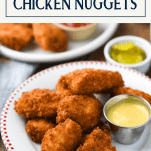 Side shot of a plate of the best chicken nuggets recipe with text title box at top