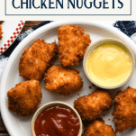 Overhead shot of a plate of fried chicken nugget recipe with text title box at top