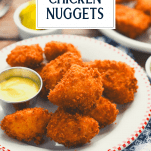 Side shot of a plate of fried chicken nuggets with text title overlay