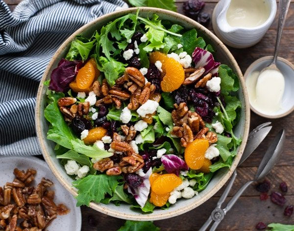 Horizontal overhead shot of a homemade house salad with creamy dressing and blue cheese