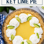 Overhead shot of a homemade key lime pie with text title box at top