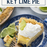Slice of the best key lime pie recipe on a plate with text title overlay