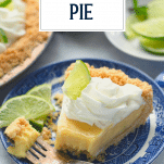 Slice of key lime pie on a plate with text title overlay