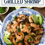 Close overhead shot of a plate of marinated grilled shrimp with text title box at top