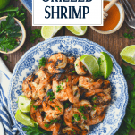 The best grilled shrimp marinade served on a blue and white plate with text title overlay