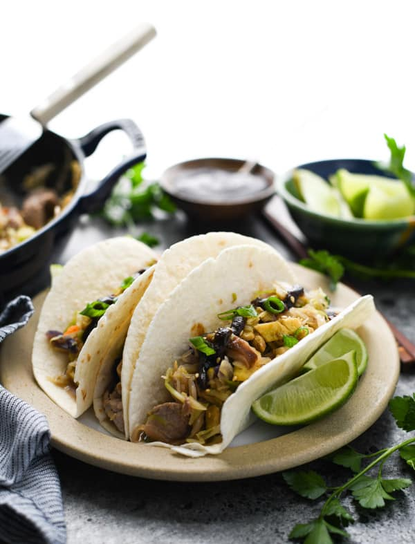 Easy moo shu pork recipe served with pancakes on a plate
