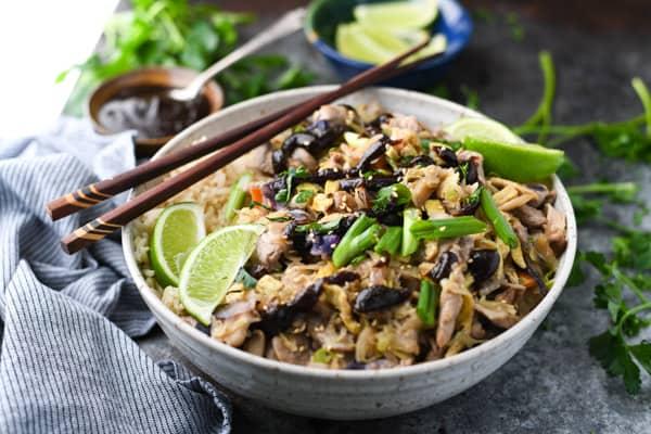 Horizontal shot of a bowl of moo shu pork with rice