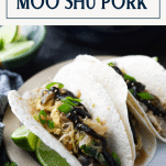 Side shot of moo shu pork pancakes with text title box at top