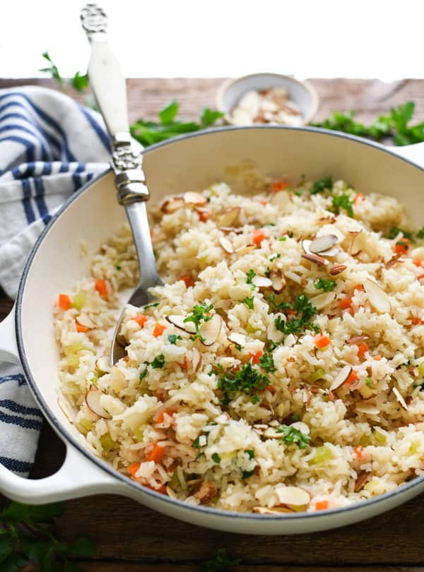 Vegetable rice pilaf in a white skillet