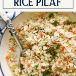Overhead shot of rice pilaf in a pan with text title box at top