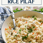 Side shot of a skillet of vegetable rice pilaf with text title box at top
