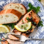 Close overhead shot of a piece of marinated grilled salmon with lemon