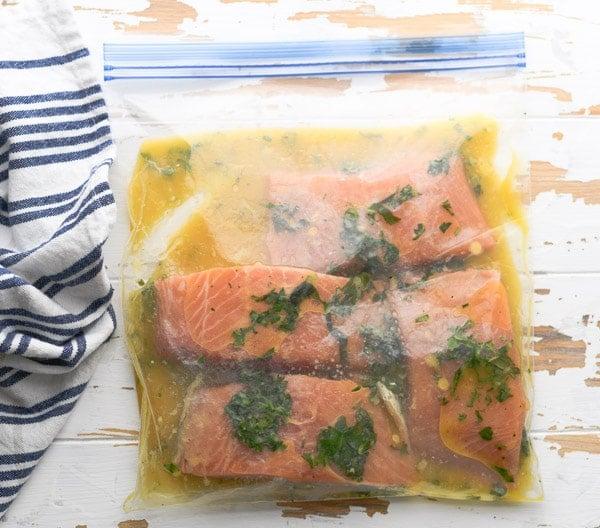 Process shot showing how to make salmon marinade