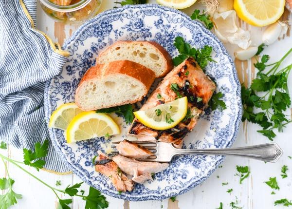 Overhead horizontal shot of salmon marinade lemon and herbs