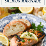 Piece of marinated grilled salmon with lemon on a plate with text title box at top