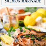 Two pieces of grilled salmon with text title box at top