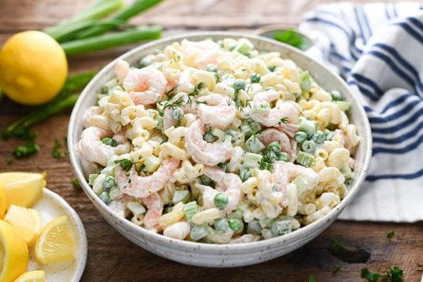 Horizontal shot of a bowl of shrimp and pasta salad.