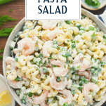 Overhead shot of a bowl of southern shrimp pasta salad with text title overlay