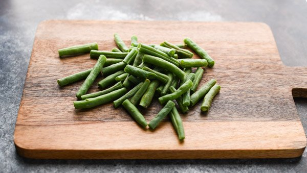 Fresh green beans on a cutting board