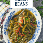 Easy southern green beans in a blue and white dish with text title overlay