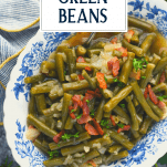 Blue and white dish full of southern style green beans with text title overlay