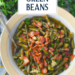 Overhead shot of a bowl of southern style green beans with text title overlay