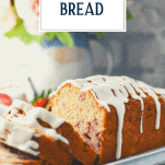 Fresh strawberry bread sliced on a white tray with text title overlay