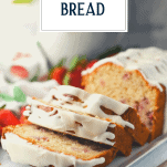 Front shot of a sliced loaf of strawberry bread with text title overlay