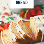 Sliced loaf of fresh strawberry bread with text title overlay