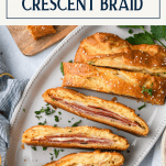 Sliced stromboli crescent braid on a platter with text title box at top