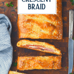 Overhead shot of a sliced homemade stromboli sandwich with text title overlay