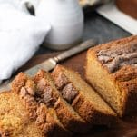 Amish Friendship Bread without starter on a cutting board with a creamer and eggs in the background