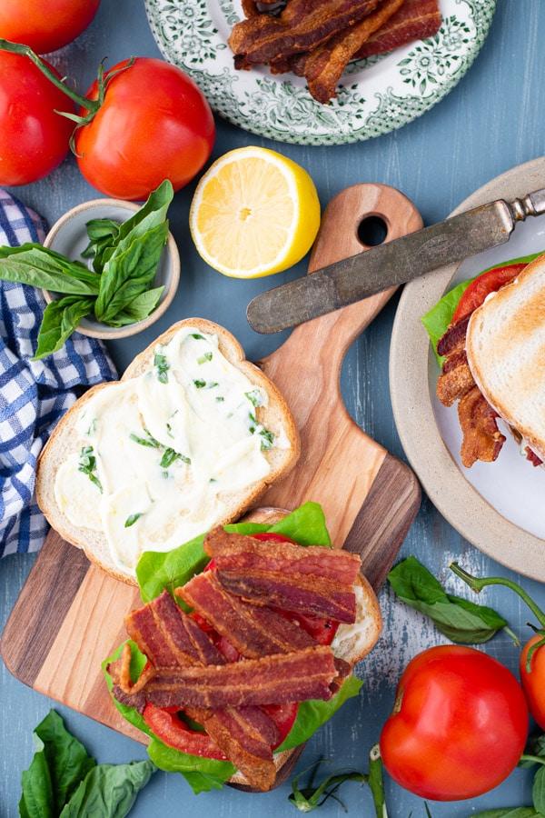 Process shot showing how to assemble the best BLT sandwich recipe