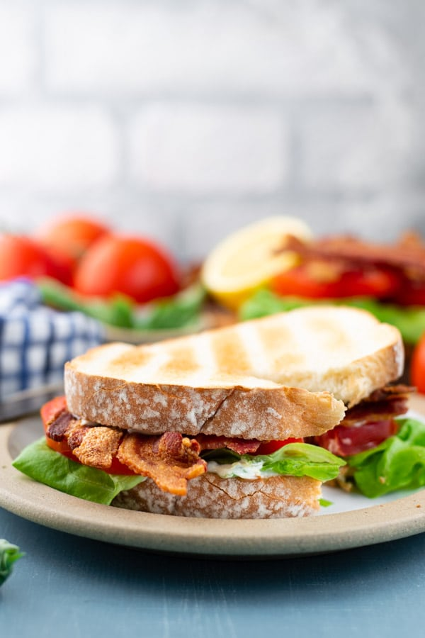 Side shot of the best BLT sandwich on a plate