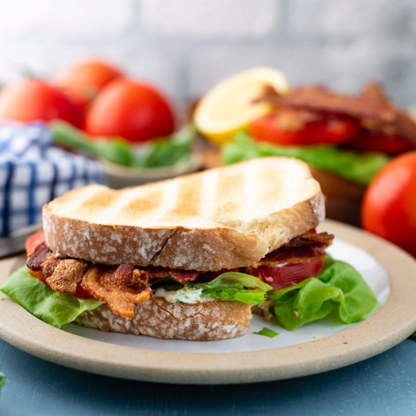 Square image of a BLT sandwich on a plate