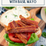 A classic BLT sandwich on a wooden cutting board with text title box at the top
