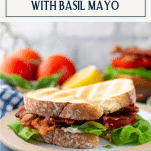 Side shot of a plate of the best BLT sandwich recipe with text title box at top