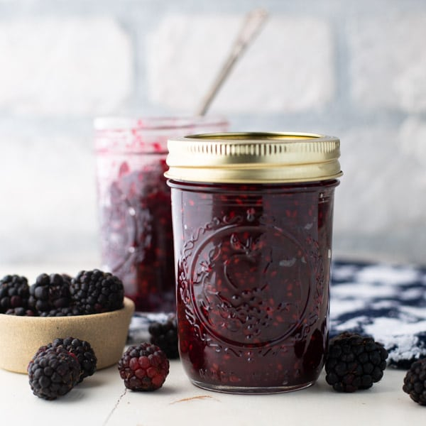 Side shot of two jars of small batch blackberry jam