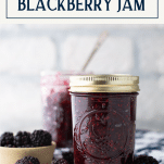 Jar of easy homemade blackberry jam on a table with text title box at top