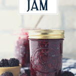 Jar of blackberry jam with text title overlay
