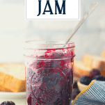Front shot of a jar of homemade blackberry jam with text title overlay